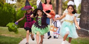 kids in costumes running