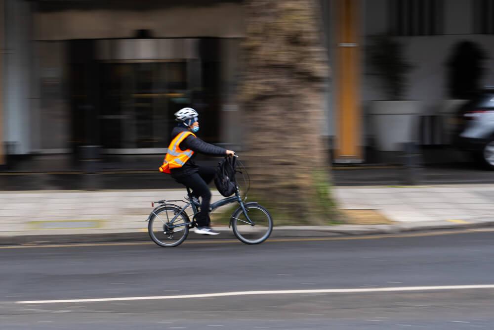 Cyclist riding a bike on a city road.